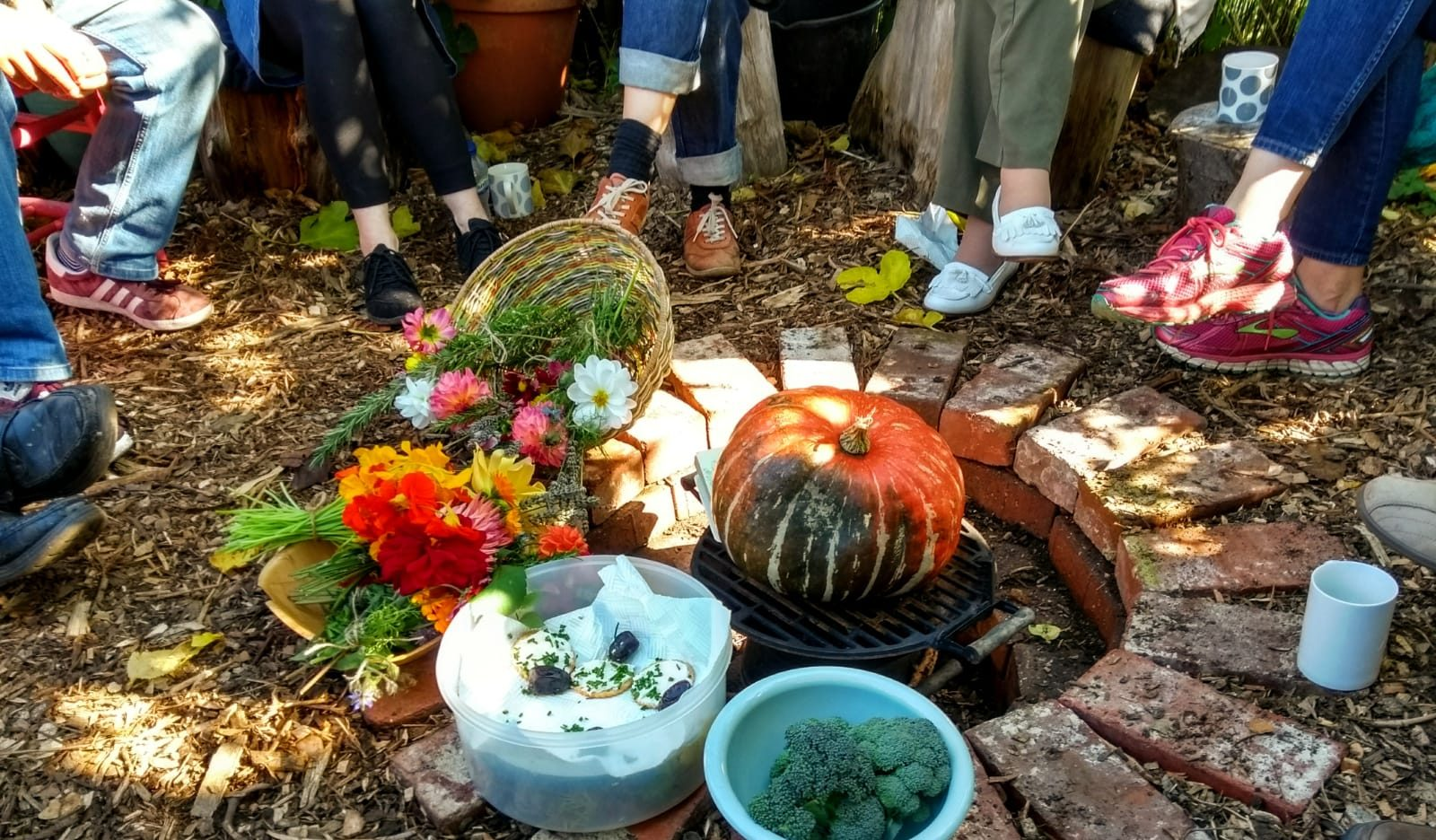 feet around a fire pit filled with harvest