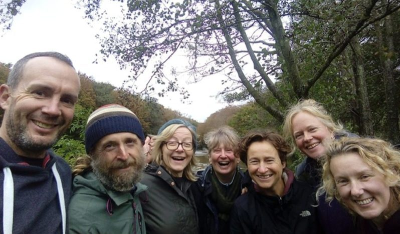 group of smiling people outside